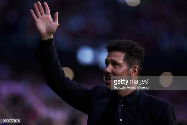 Head coach Diego Pablo Simeone of Atletico de Madrid waves the audience prior to start the La Liga match between Club Atletico Madrid and Real Betis...