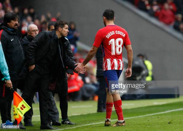 Head coach Diego Pablo Simeone of Atletico Madrid and Diego Costa of Atletico Madrid shake hands during the La Liga match between Atletico Madrid and...