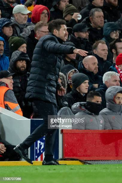 head coach Diego Simeone of Atletico Madrid controls the ball during the UEFA Champions League round of 16 second leg match between Liverpool FC and...