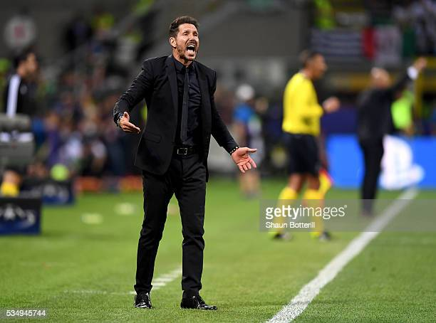 Head coach Diego Simeone of Atletico Madrid urges on his side during the UEFA Champions League Final match between Real Madrid and Club Atletico de...