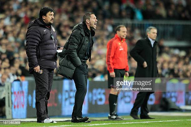 Head coach Diego Simeone of Club Atletico de Madrid gives instructions with assitant coach German Burgos during the La Liga match between Real Madrid...