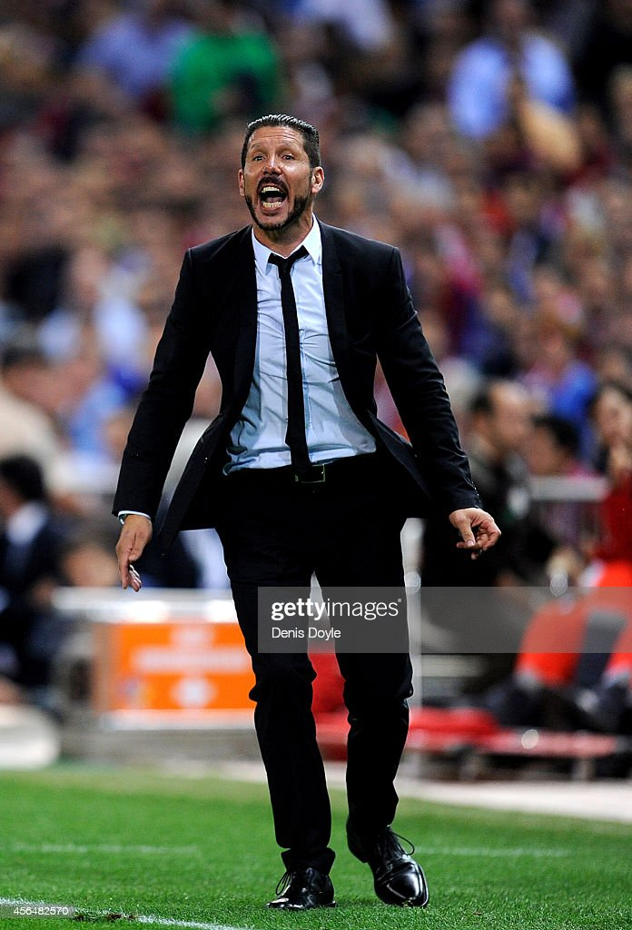 Head coach Diego Simeone of Club Atletico de Madrid reacts during the UEFA Champions League Group A match between Club Atletico de Madrid and Juventus at Vicente Calderon Stadium on October 1, 2014 in Madrid, Spain.