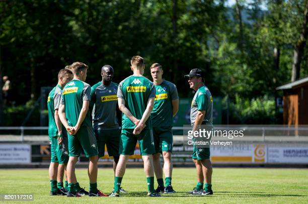Head Coach Dieter Hecking and Co Trainer Otto Addo talk to the young players Nils Ruetten Moritz Nicolas Florian Mayer Louis Beyer and Mike...