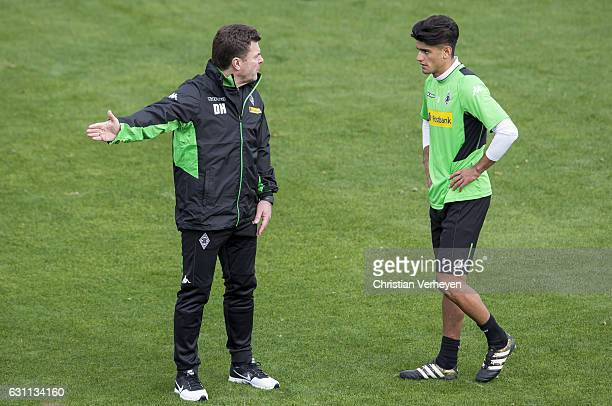 Head Coach Dieter Hecking gives instructions to Mahmoud Dahoud during a Training Session at Borussia Moenchengladbach Training Camp on January 07...