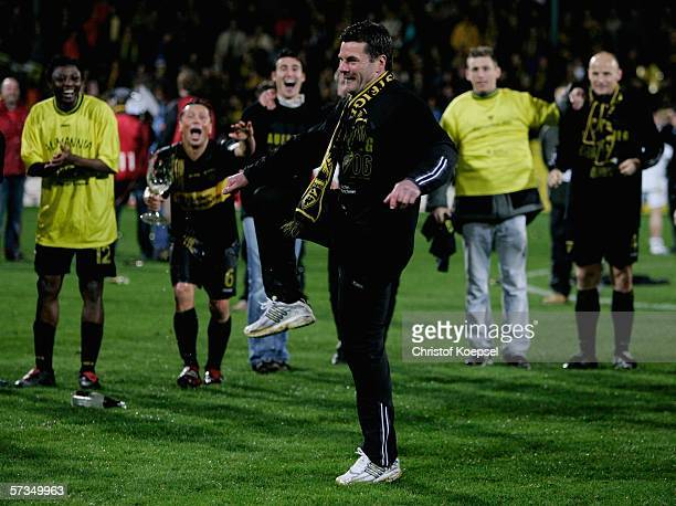 Head coach Dieter Hecking of Aachen dances after the promotion during the Second Bundesliga match between Alemannia Aachen and VFL Bochum at the...