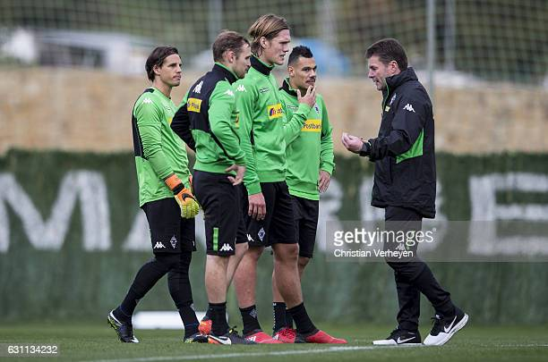 Head Coach Dieter Hecking of Borussia Moenchengladbach gives instructions to Tony Jantschke Jannik Vestergaard Yann Sommer and Timothee Kolodziejczak...