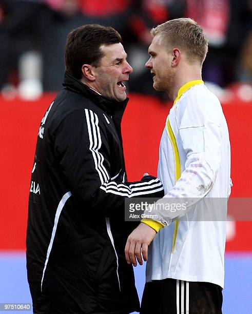 Head coach Dieter Hecking of Nuernberg celebrates with Andreas Wolf after the Bundesliga match between 1. FC Nuernberg and Bayer Leverkusen at Easy...