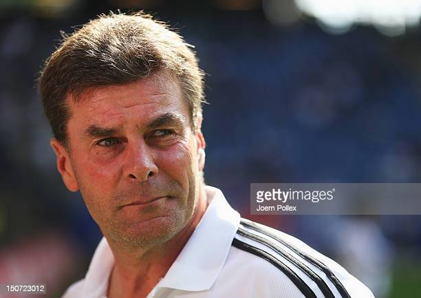 Head coach Dieter Hecking of Nuernberg looks on prior to the Bundesliga match between Hamburger SV and 1 FC Nuernberg at Imtech Arena on August 25...
