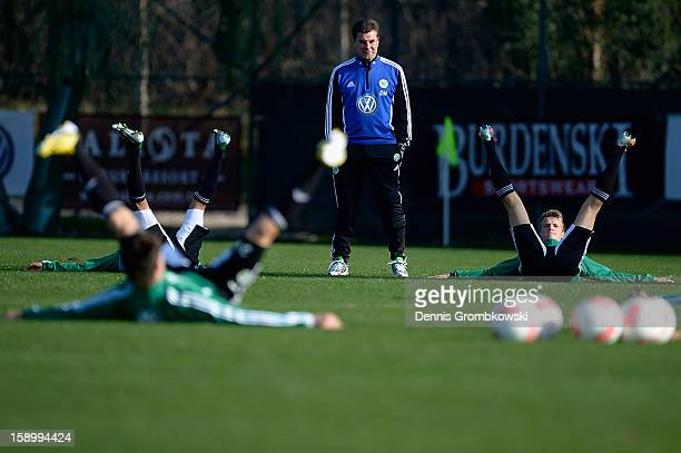 Head coach Dieter Hecking of Wolfsburg watches his team during a training session at day two of their Training Camp on January 5, 2013 in Belek,...