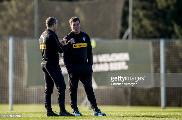 Head Coach Dieter Hecking talks to Assistant Coach Frank Geideck during a training session at Borussia Moenchengladbach Training Camp on January 05,...