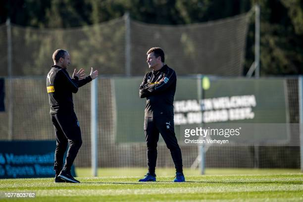Head Coach Dieter Hecking talks to Assistant Coach Frank Geideck during a training session at Borussia Moenchengladbach Training Camp on January 05...