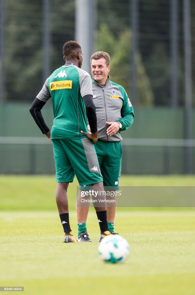 Head Coach Dieter Hecking talks to Denis Zakaria during the training session of Borussia Moenchengladbach at Borussia-Park on August 18, 2017 in Moenchengladbach, Germany.