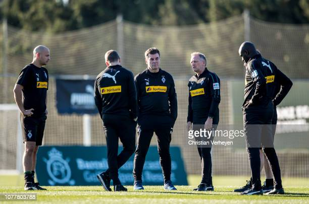 Head Coach Dieter Hecking talks to his Assistant Coaches during a training session at Borussia Moenchengladbach Training Camp on January 05 2019 in...
