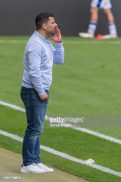 Head coach Dimitrios Grammozis of FC Schalke 04 gestures during the Bundesliga match between TSG Hoffenheim and FC Schalke 04 at PreZero-Arena on May...