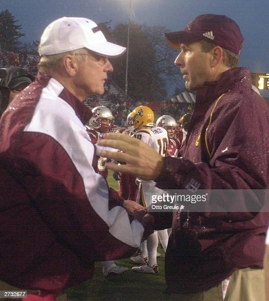 Head Coach Dirk Koetter of the Arizona State Sun Devils shakes hands with Head Coach Bill Doba of the Washington State University Cougars on November...