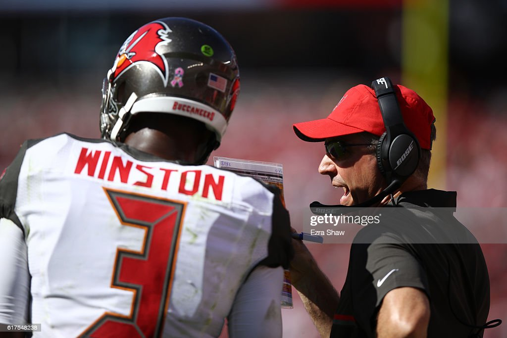 Head coach Dirk Koetter of the Tampa Bay Buccaneers speaks with Jameis Winston #3 on the sidelines during their NFL game against the San Francisco 49ers at Levi's Stadium on October 23, 2016 in Santa Clara, California.