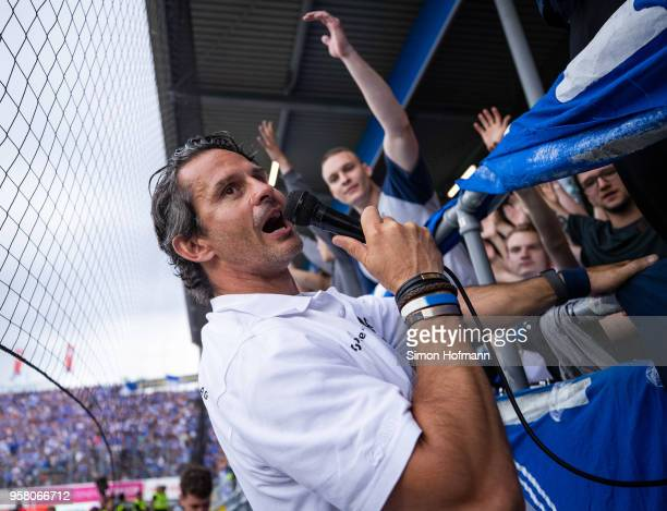 Head coach Dirk Schuster of Darmstadt celebrates winning with supporters after the Second Bundesliga match between SV Darmstadt 98 and FC Erzgebirge...