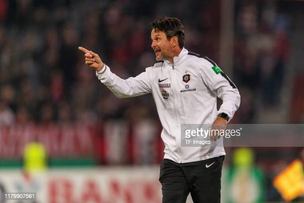 head coach Dirk Schuster of Erzgebirge Aue gestures during the DFB Cup second round match between Fortuna Duesseldorf and Erzgebirge Aue at Merkur...