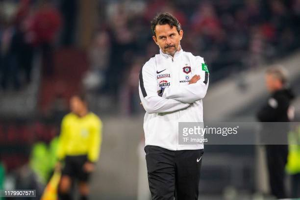 head coach Dirk Schuster of Erzgebirge Aue looks dejected during the DFB Cup second round match between Fortuna Duesseldorf and Erzgebirge Aue at...