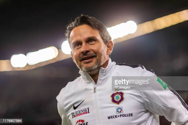head coach Dirk Schuster of Erzgebirge Aue looks on prior to the DFB Cup second round match between Fortuna Duesseldorf and Erzgebirge Aue at Merkur...