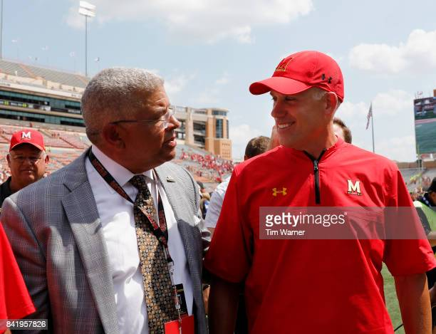 Head coach DJ Durkin of the Maryland Terrapins and athletic director Kevin Anderson walk off the field after defeating the Texas Longhorns at Darrell...