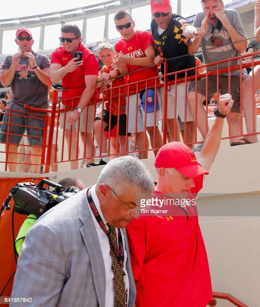 Head coach DJ Durkin of the Maryland Terrapins walks off the field with athletic director Kevin Anderson after defeating the Texas Longhorns at...