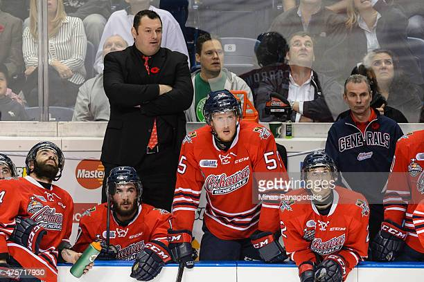 Head coach DJ Smith of the Oshawa Generals gets onto the bench during the 2015 Memorial Cup Championship against the Kelowna Rockets at the Pepsi...