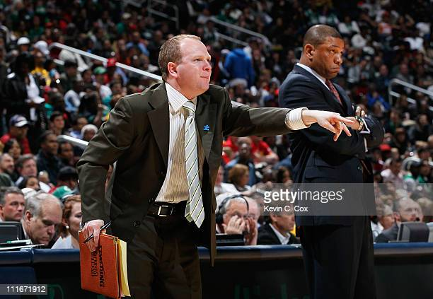 Head coach Doc Rivers and assistant coach Lawrence Frank of the Boston Celtics against the Atlanta Hawks at Philips Arena on April 1 2011 in Atlanta...
