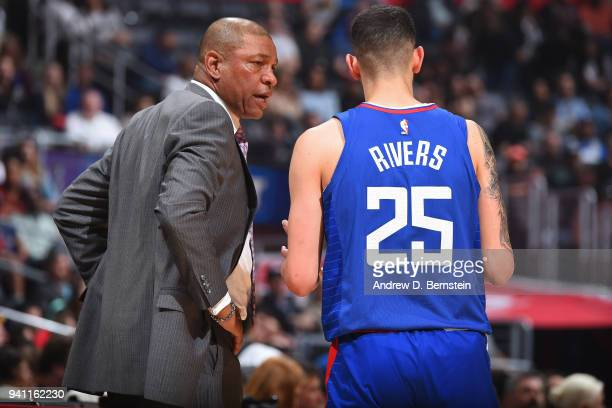 Head Coach Doc Rivers and Austin Rivers of the LA Clippers talk during the game against the Indiana Pacers on April 1 2018 at STAPLES Center in Los...