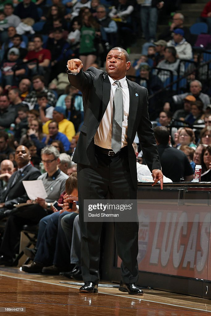 Head Coach Doc Rivers of the Boston Celtics calls a play from the bench against the Minnesota Timberwolves during the game on April 1, 2013 at Target Center in Minneapolis, Minnesota.