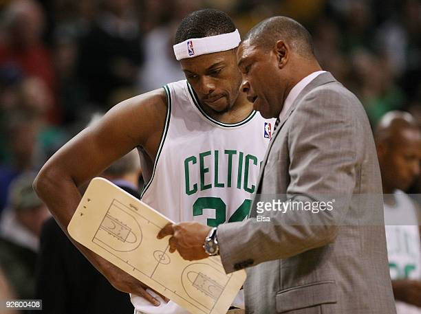 Head coach Doc Rivers of the Boston Celtics goes over a play with Paul Pierce before the game against the New Orleans Hornets at the TD Garden on...
