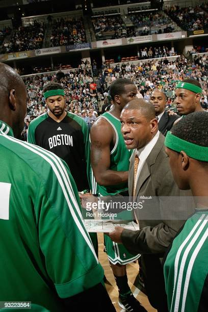 Head Coach Doc Rivers of the Boston Celtics huddles with his team during a break from the game against the Indiana Pacers on November 14 2009 at...