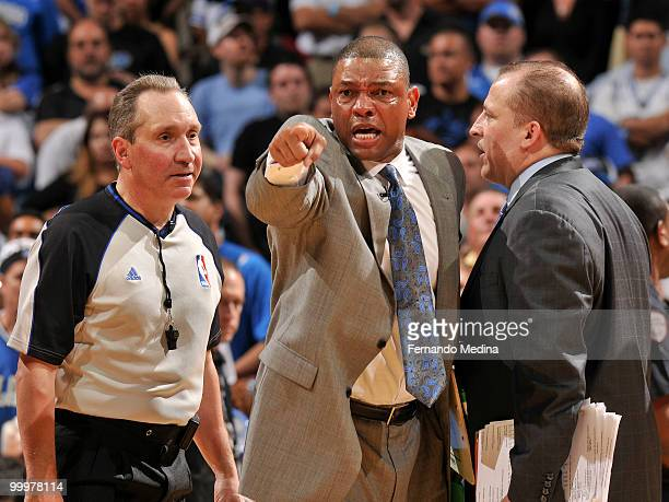 Head coach Doc Rivers of the Boston Celtics makes a point to referee Joe DeRosa as assistant coach Tom Thibodeau looks on during a time out against...
