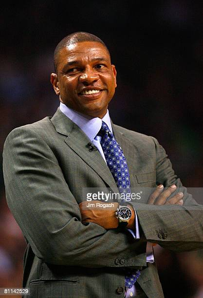Head coach Doc Rivers of the Boston Celtics smiles on court against the Cleveland Cavaliers in Game Seven of the Eastern Conference Semifinals during...