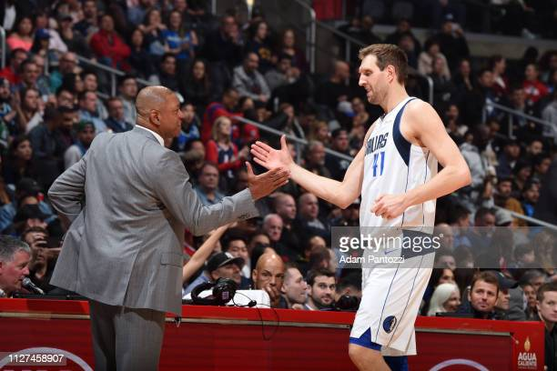 Head Coach Doc Rivers of the LA Clippers and Dirk Nowitzki of the Dallas Mavericks highfive on February 25 2019 at STAPLES Center in Los Angeles...