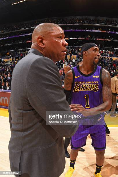 Head Coach Doc Rivers of the LA Clippers and Kentavious CaldwellPope of the Los Angeles Lakers shake hands after a game against the Los Angeles...