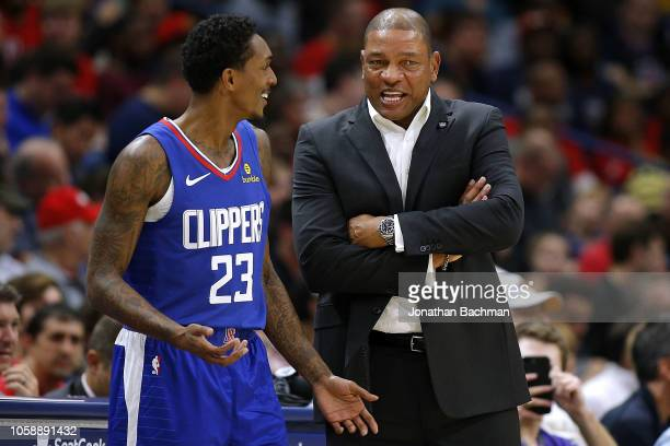 Head coach Doc Rivers of the LA Clippers and Lou Williams react during the first half against the New Orleans Pelicans at the Smoothie King Center on...