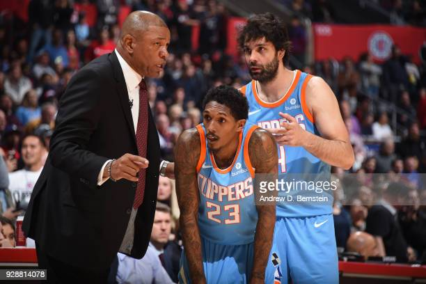 Head Coach Doc Rivers of the LA Clippers speaks to Lou Williams of the LA Clippers and Milos Teodosic of the LA Clippers during the game against the...