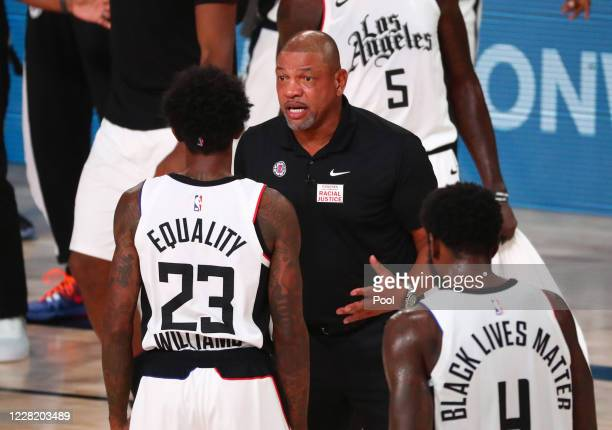 Head coach Doc Rivers of the LA Clippers talks with guard Lou Williams in the first half against the Dallas Mavericks in game five of the first round...