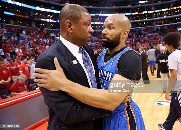 Head coach Doc Rivers of the Los Angeles Clippers enmbraces Derek Fisher of the Oklahoma City Thunder after the Thunder's victory in Game Six of the...