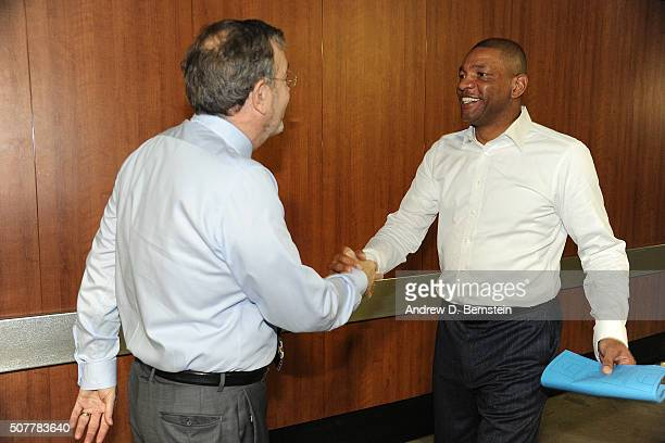 Head coach Doc Rivers of the Los Angeles Clippers shakes hands with P J Carlesimo before the game between the Los Angeles Clippers and the Chicago...