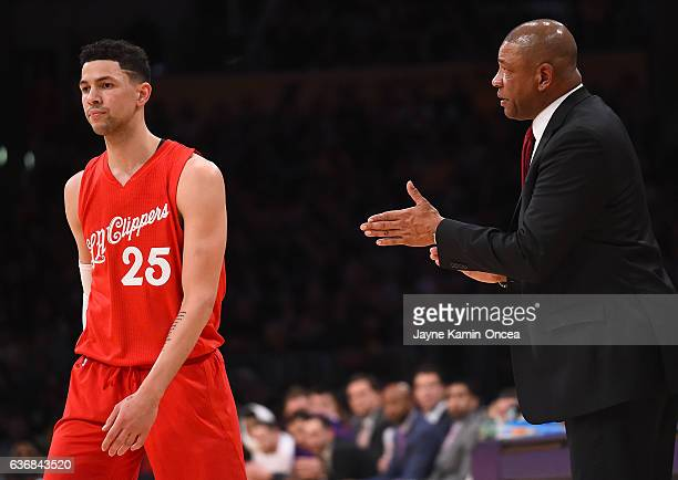 Head coach Doc Rivers of the Los Angeles Clippers talks to Austin Rivers of the Los Angeles Clippers in the second half of the game against the Los...