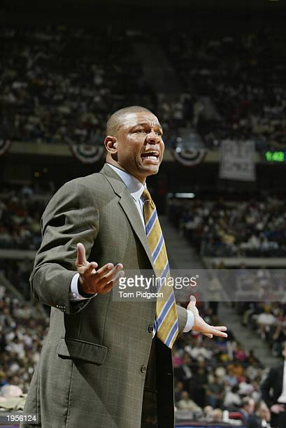 Head coach Doc Rivers of the Orlando Magic reacts to Game one of the Eastern Conference Quarterfinals during the 2003 NBA Playoffs against the...