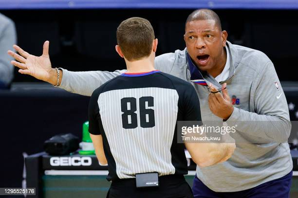 Head coach Doc Rivers of the Philadelphia 76ers speaks with referee Brandon Schwab at Wells Fargo Center on January 09, 2021 in Philadelphia,...