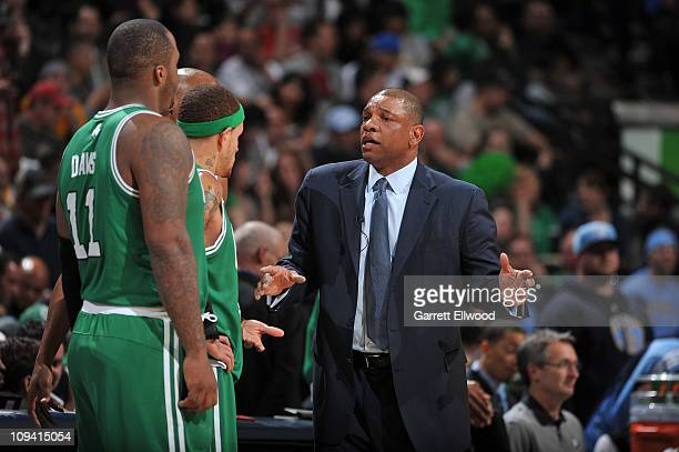 Head coach Doc Rivers talks with Glen Davis Delonte West and Ray Allen of the Boston Celtics during a time out against the Denver Nuggets on February...