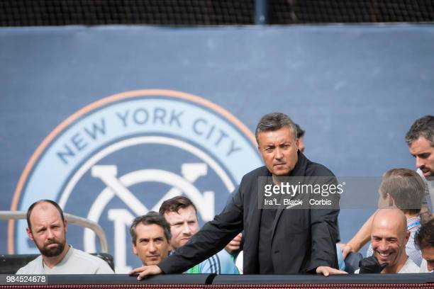 Head Coach Domenec Torrent of New York City watches with NYCFC logo in the background during the MLS match between New York City FC and Toronto FC at...