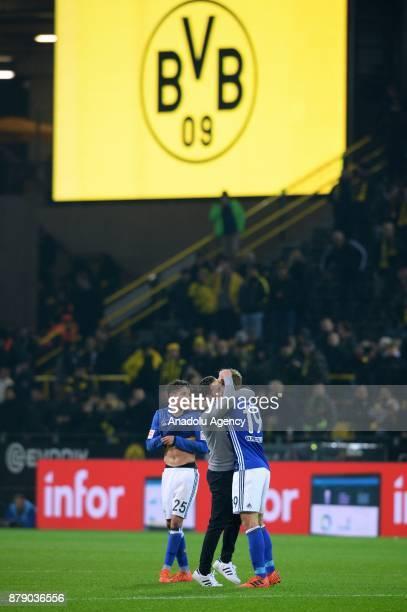 Head coach Domenico Tedesco Amine Harit and Guido Burgstaller of Schalke celebrate after Bundesliga soccer match between Borussia Dortmund and FC...