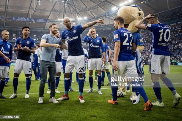 Head Coach Domenico Tedesco and Naldo of FC Schalke celebrate with players after the Bundesliga match between FC Schalke 04 and Borussia Dortmund at...