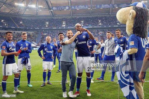 Head coach Domenico Tedesco and Naldo of Schalke celebrate with the fans after the Bundesliga match between FC Schalke 04 and Borussia Dortmund at...