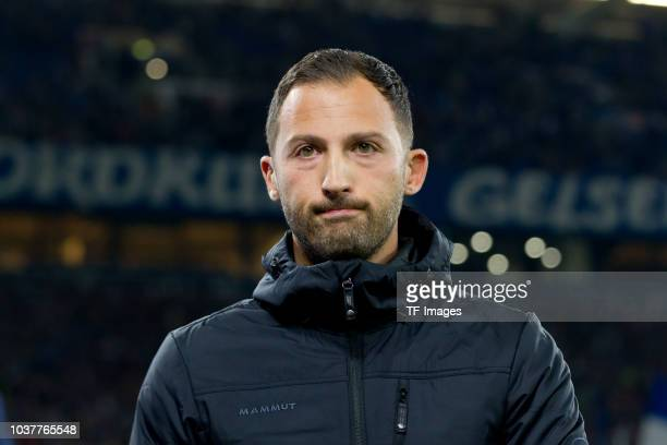 Head coach Domenico Tedesco of FC Schalke looks dejected during the Bundesliga match between FC Schalke 04 and FC Bayern Muenchen at VeltinsArena on...